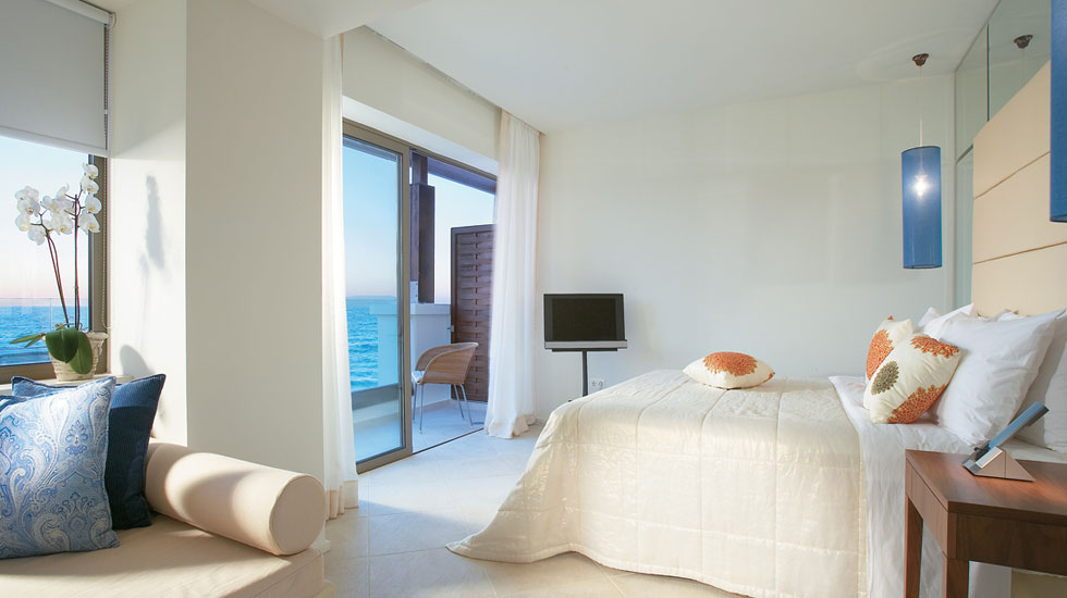 Luxury Guestroom | Private enclosed balcony with glass and wood panels offers breathtaking panoramic sea or sea & lagoons view