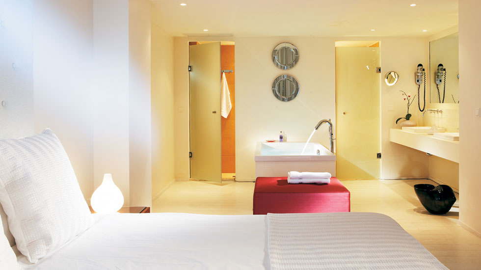Luxury One Bedroom Suite | Luxurious bathroom with sea view bathtub, his & hers vanity unit and separate shower & WC cabins