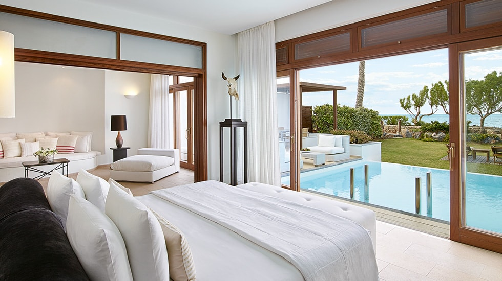 Presidential Villa|Master bedroom with direct sea view and glass-fronted door leading to the private infinity pool