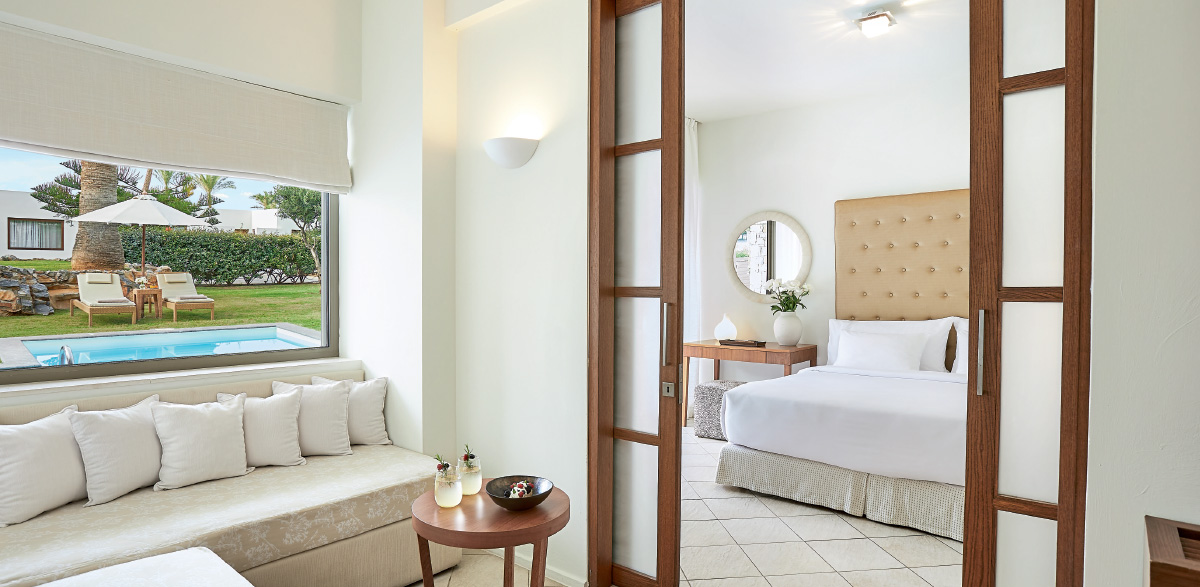 02-bedroom-area-and-sofa-beds-in-amirandes-family-suite-with-private-pool
