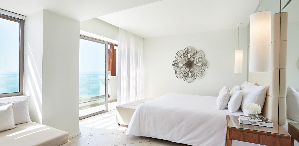 luxury-guestroom-in-amirandes-grecotel-boutique-resort-bedroom-with-sea-views
