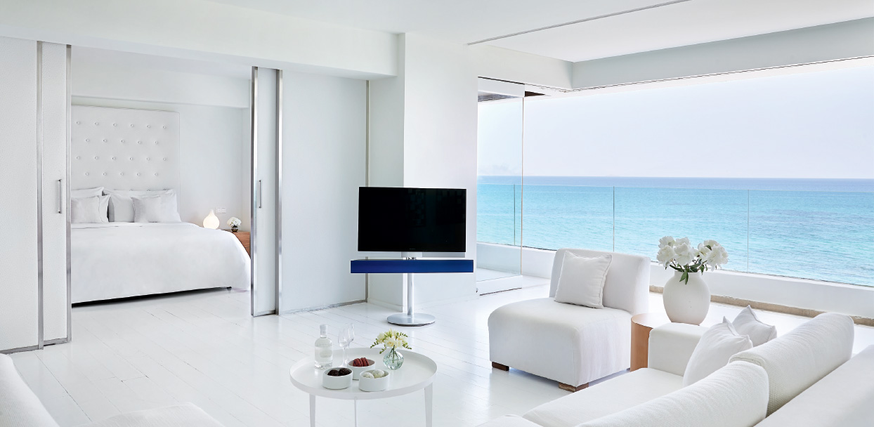 01-amirandes-one-bedroom-grand-suite-lounge-and-bedroom-with-amazing-sea-view